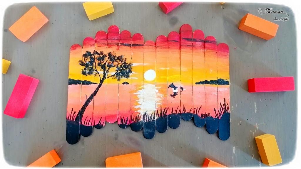 Activité créative et manuelle enfants - activité autonome de ma fille de 11 ans - Peinture sur bâtonnets de glace - Dégradés de couleur pour le coucher de soleil et noir pour les détails - Technique au couteau puis pinceau - Récup' - Arts visuels cycle 3 - peinture - Couleurs chaudes - Thème dauphin, mer, plage été - Découverte d'une technique artistique - Créativité - Océan - mslf